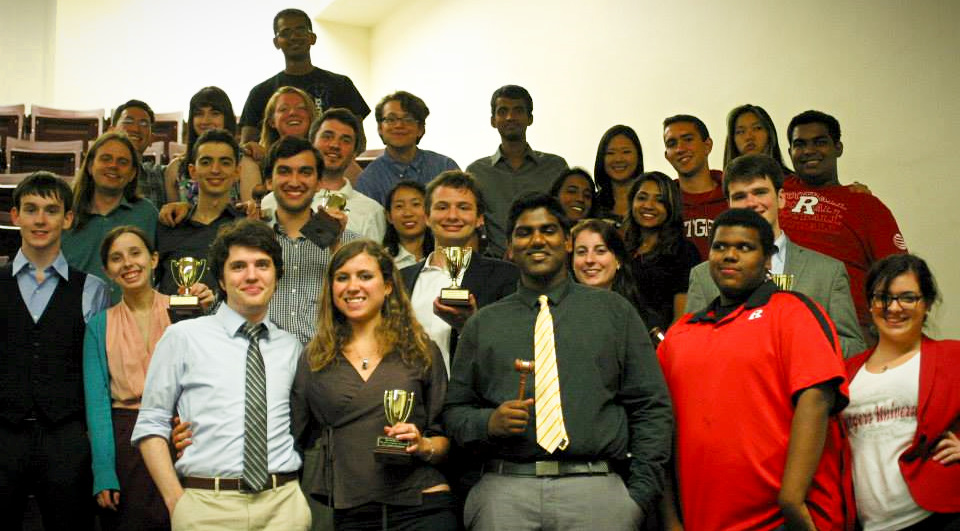 The contingent of Rutgers debaters gathered with their awards at the end of the first tournament of the year.  Left to right:  Sean Leonard, Storey Clayton, Alex Jubb, Chris Bergman, Raynee Morris, Arbi Llaveshi, Henry Phipps, Jamie DiVito, Quinn Maingi, Daimler Vadlamuri, Gordon Morrisette, Becky Ratero, Zach Sinkiewicz, Lin Lan, Russell Potter, George Alukal, Vidhaath Sripathi, Sweta Devarajan, Ashley Novak, Rachel Moon, Pardip Kaur, Joe Casais, Maxwell Williams, Nick Hansen, Kai Rau, Atif Ahmad, and Gabi Cozzolino.